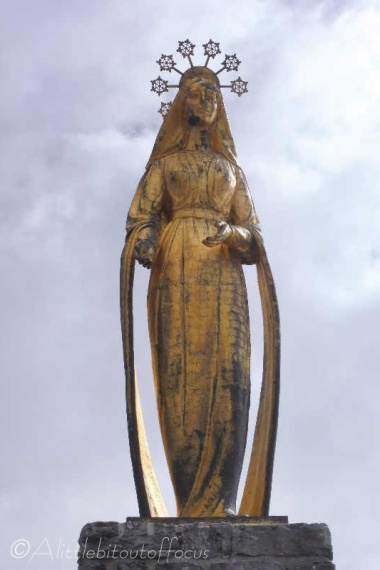 11 Golden Madonna statue