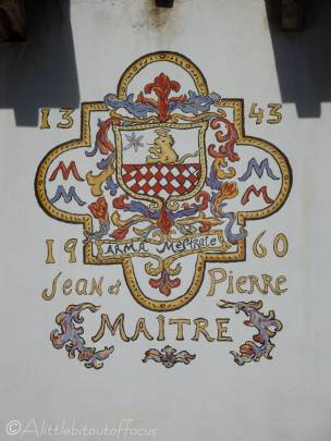 21 Crest on chalet wall