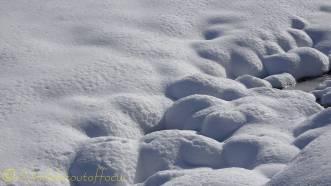 11 snowy rocks
