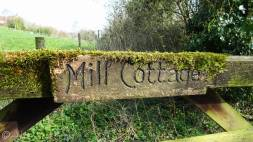 2 Moss covered gate sign