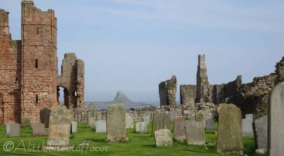 11 Lindisfarne Priory and distant Castle