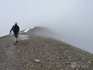 37 Heading for the final ridge descent in the mist